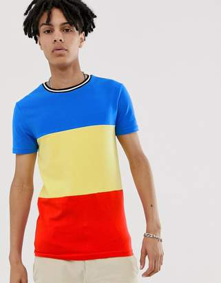 Asos DESIGN muscle fit t-shirt in primary color block and monochrome tipping