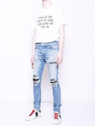 Amiri Mx1 leather patch jeans