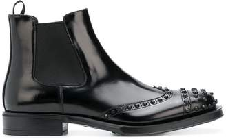 Prada perforated studded Chelsea boots