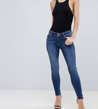 Asos DESIGN Petite Lisbon midrise skinny jeans in kyla wash with raw hem