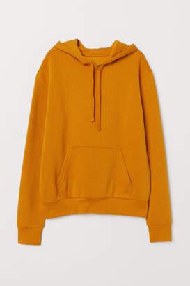 H&M Hooded Sweatshirt with Motif - Yellow
