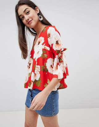 Girls On Film floral tie sleeve blouse