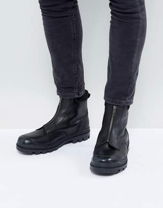 Asos DESIGN Chelsea Boots In Black Leather With Front Zip Detail And Cleated Sole