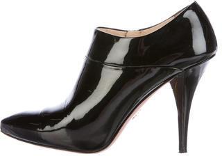 pradaPrada Glittered Patent Leather Booties
