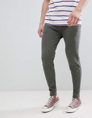 Asos Design Skinny Joggers In Khaki Vintage Wash With Cut And Sew Panel
