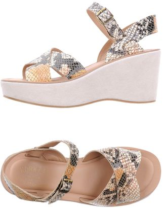KORK-EASE Sandals $142 thestylecure.com