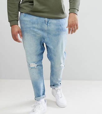 Asos DESIGN Plus Drop Crotch Jeans In Mid Wash Blue With Rips