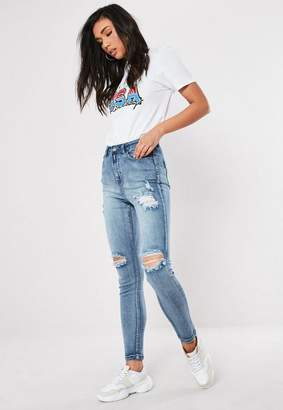 Missguided Blue Ripped Knee Jeans