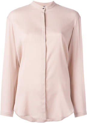 Eleventy top with discreet front fastening