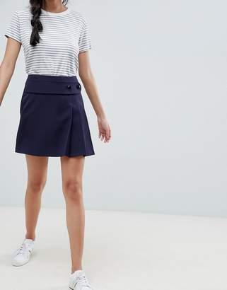 Asos Design DESIGN kilt mini skirt with self belt and pleats
