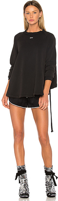 OFF-WHITE Back Ruffle Sweater in Black $702 thestylecure.com