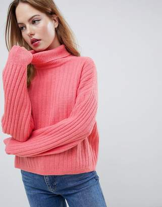 Asos Design DESIGN fluffy sweater in rib with roll neck