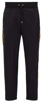 Versace Printed Satin Track Pants - Mens - Black