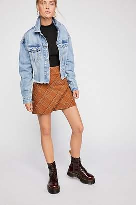 Overlapping Raw Mini Skirt