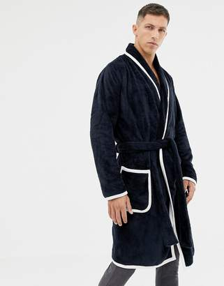 Asos DESIGN fluffy robe in navy with ecru piping