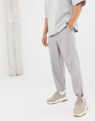 Asos tapered sweatpants in flat gray nylon with belt