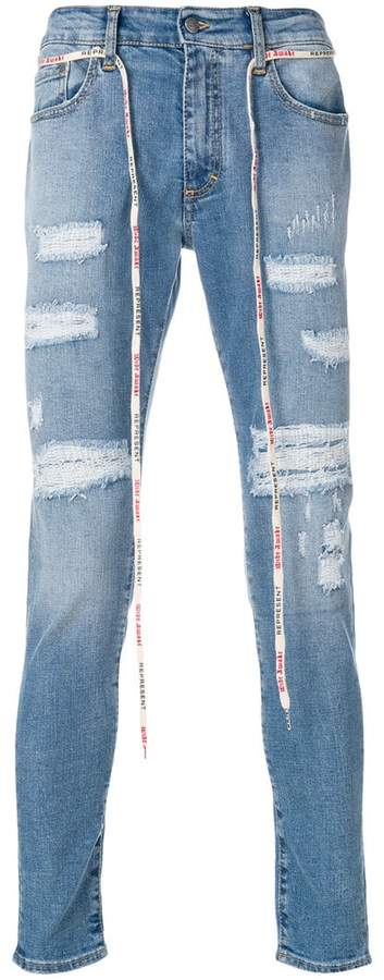 Represent distressed detail jeans