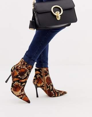 Asos Design DESIGN Evon leather heeled boots in leopard print