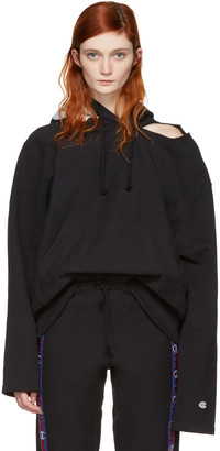 Vetements Black Champion Edition Open Shoulder Hoodie $830 thestylecure.com