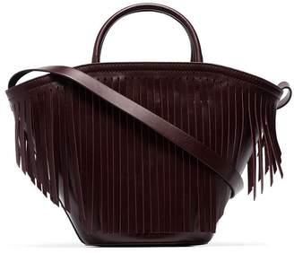 Trademark burgundy leather fringed tote bag