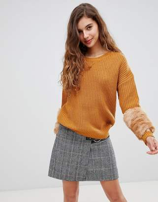 Paige Willow and Willow & oversized cable knit sweater with faux fur cuffs