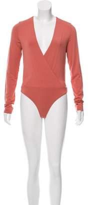 Protagonist Long Sleeve Surplice Neck Bodysuit w/ Tags