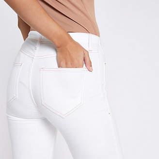 River Island White Harper raw hem super skinny jeans