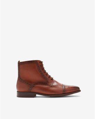 Express leather side zip wingtip boot
