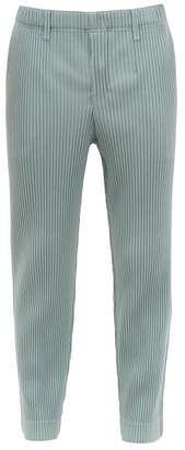 Issey Miyake Homme Plissé Homme Plisse Straight Leg Pleated Trousers - Mens - Light Blue