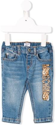 Moschino Kids leopard print logo jeans