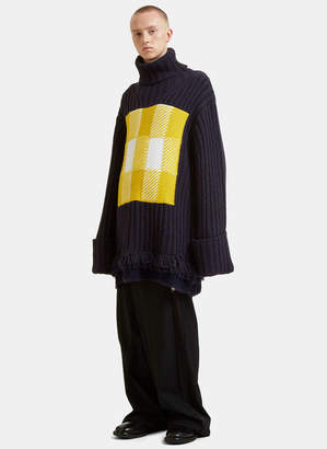 J.W.Anderson Checked Roll Neck Fringed Knit Sweater in Navy