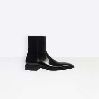 Balenciaga Glazed calfskin zipped boots in black glazed leather