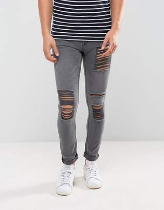 New Look Skinny Jeans With Extreme Rips In Gray Wash