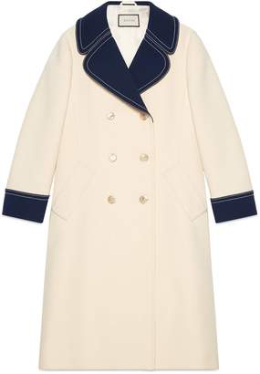Wool coat with contrast details