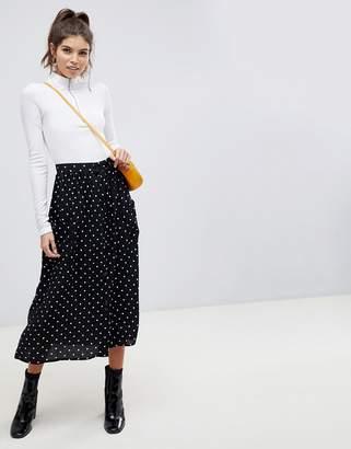 Asos DESIGN button through midi skirt in polka dot with oversized pockets