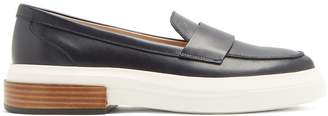 Tod's Leather and rubber loafers
