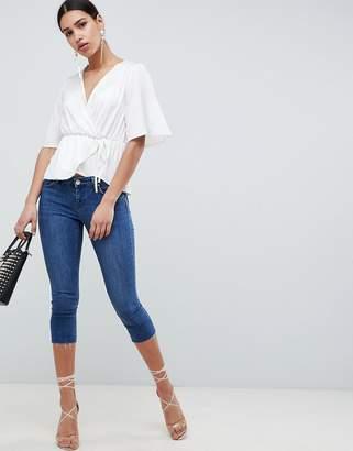 Asos Design DESIGN Whitby Low Rise Skinny Jeans In Capri Length In London Blue