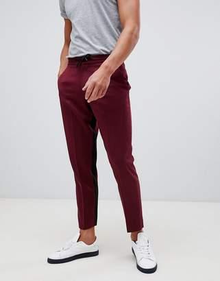 Asos DESIGN cigarette crop PANTS in burgundy with contrast insert stripe