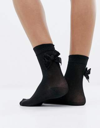 Monki glitter socks with bow in black