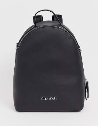 b1034a6a3d2 Calvin Klein Jeans Calvin Klein leather look backpack with wide print  detail strap