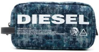 Diesel zipped pouch in lasered denim