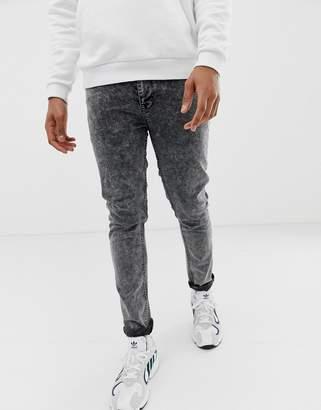 Asos Design DESIGN skinny jeans in acid wash black