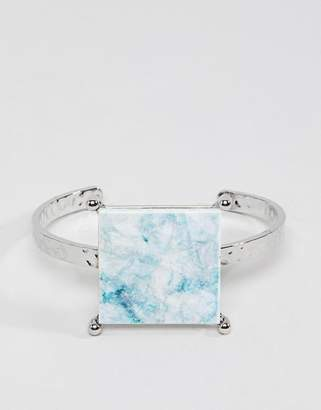 Asos DESIGN cuff bracelet with colored marble effect recycled cotton stone