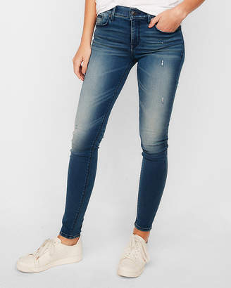 Express Mid Rise Ripped Extreme Stretch Jean Leggings