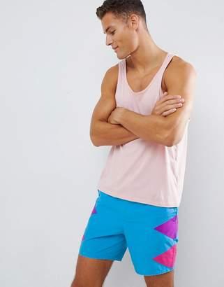 Asos Design DESIGN swim shorts with diamond side cut & sew design in mid length