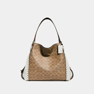 Coach Edie Shoulder Bag 31 In Signature Canvas With Rivets bb6849875d663