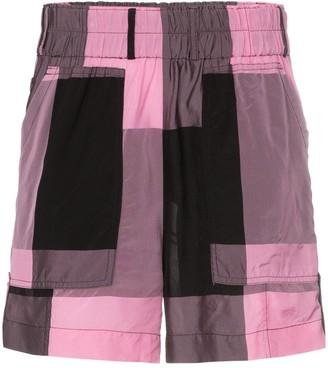 Ganni check print track shorts