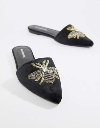 Glamorous Black Pointed Mule With Bee Embellishment