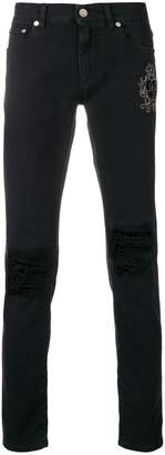 Dolce & Gabbana crest embroidered skinny jeans
