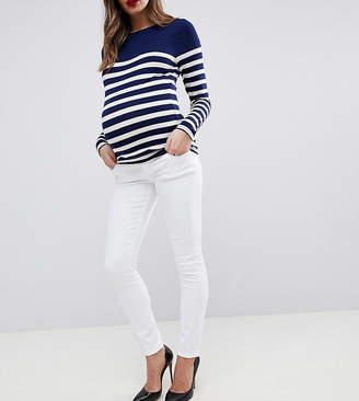 Asos DESIGN Maternity Ridley high waist skinny jeans in white with under the bump waistband